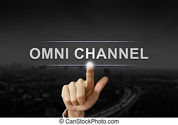 business hand pushing omni channel button on black blurred...