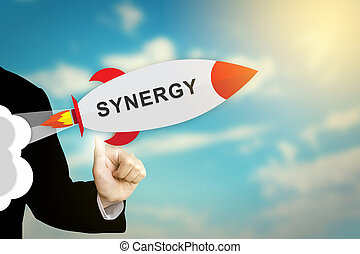business hand clicking synergy rocket - business hand...