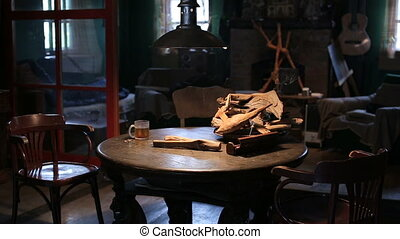 A cup of hot tea on wooden table - Smoky cup of hot tea on...