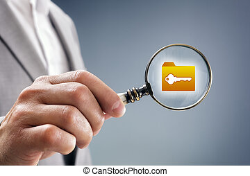 Security inspection - Businessman with magnifying glass over...