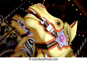 Roundabout Horses - the head of two roundabout horses at a...