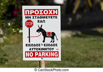 Sign for no parking in greek, in graphic shows a donkey tied...