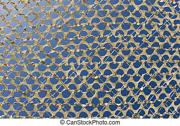 Detail of a camouflage grid - Detail of a beige camouflage...