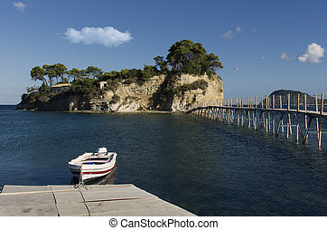 Bridge to the Cameo Island on Zakynthos Greece, small boat...