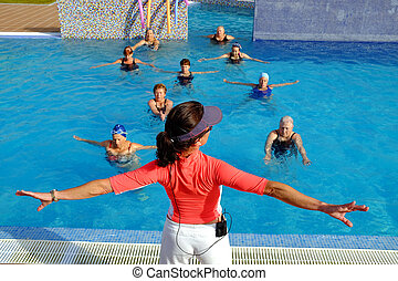 Aqua gym instructor doing senior class in pool. - Close up...