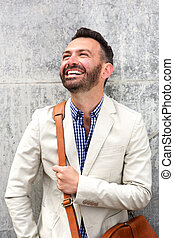 Handsome mature guy laughing