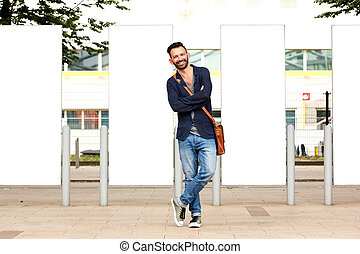 Stylish mature guy standing outdoors - Full length portrait...