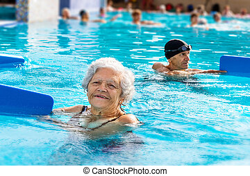 Senior woman at aqua gym session.