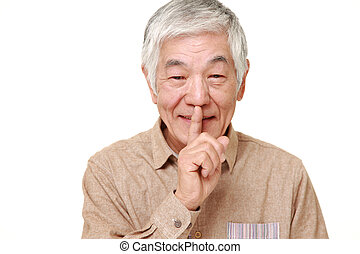 senior Japanese man whith silence gestures - studio shot of...