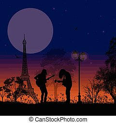 Guitarists playing in Paris on beautiful landscape
