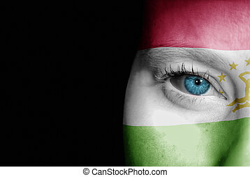 Supporter of Tajikistan - A young female with the flag of...