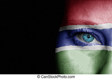 Supporter of Gambia - A young female with the flag of Gambia...