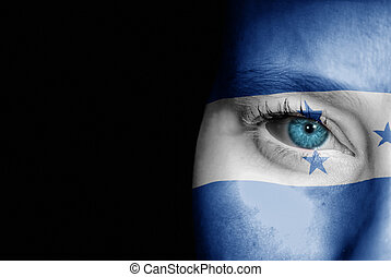 Supporter of Honduras - A young female with the flag of...