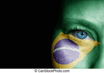 Supporter of Brazil - A young female with the flag of Brazil...