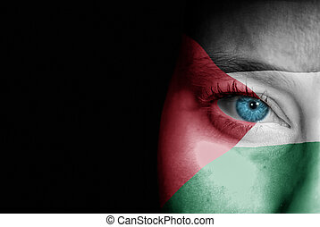 Supporter of Palestine - A young female with the flag of...
