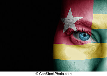 Supporter of Togo - A young female with the flag of Togo...