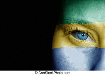 Supporter of Gabon - A young female with the flag of Gabon...