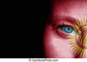 Supporter of Kyrgyzstan - A young female with the flag of...