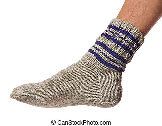 Knitted warm sock - Knitted sock on the male leg isolated on...