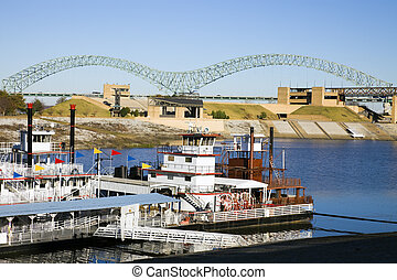 Steamboats on Mississipi - Memphis, Tennessee. The river is...