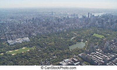 aerial view central park manhattan - heli flight over...
