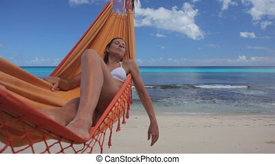 woman in hammock with shadow audio - woman in hammock under...