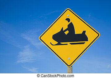 Careful Snowmobiles - road sign against blue sky