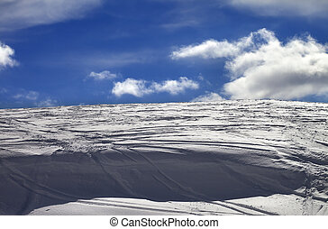 Off-piste slope and snow cornice with track from ski and...