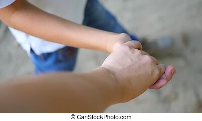 the child goes with mom holding his hand