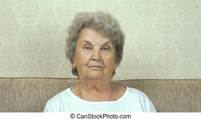 Portrait of serious senior woman with strict look - Old...