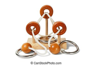 Wooden brain teaser - Wooden logic puzzle on white...