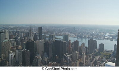 pan shot from above over upper manhattan - Aerial pan shot...