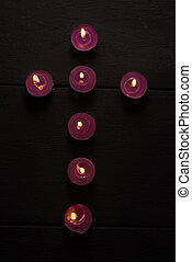 cross with candles burning