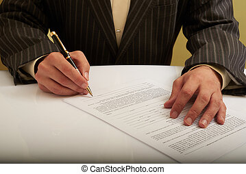 a man signs the document