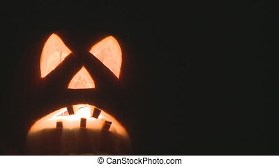 pumpkin smoke - spooky halloween pumpkin with candles inside...
