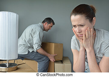 Upset woman do not want to move to a new home - Upset woman...