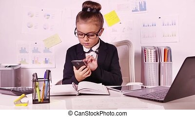 Business girl in the office - Seven years old business girl...