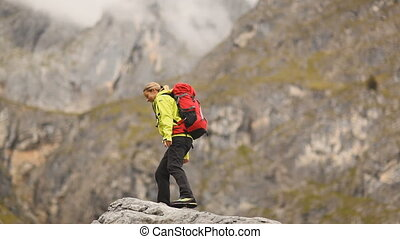 woman after reaching mountaintop - Hiking woman very happy...