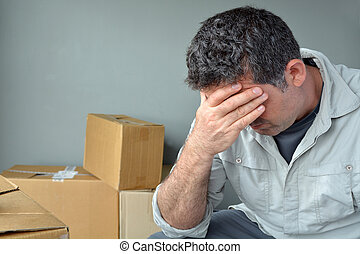 Sad evicted man worried relocating house - Sad evicted man...