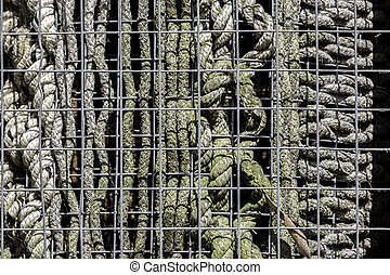Insect hotel - an abstract selection of caged rope patterns....