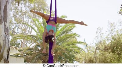 Agile supple gymnast performing an acrobatic dance - Agile...