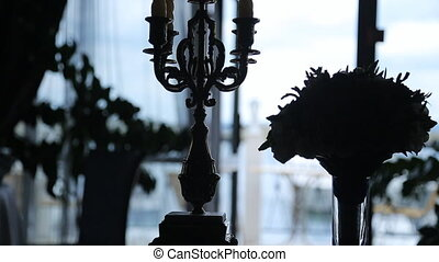 Close up view of silhouettes of decorated aristocratic room....