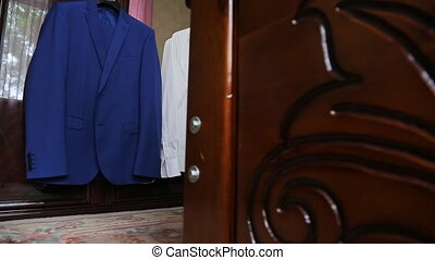 Down view on groom walking in room preparing for wedding....