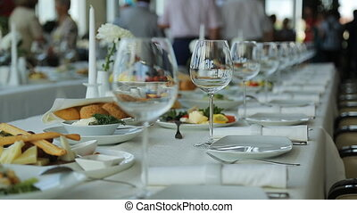 Close up view of served banquet table prepared for...