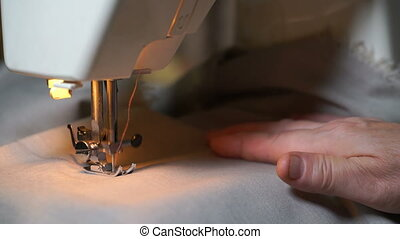 footage of woman sews on the sewing machine. 4K video