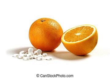 Vitamin C Oranges - A cut in half orange next to vitamin C...
