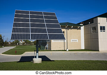 Solar panel in front of the building.