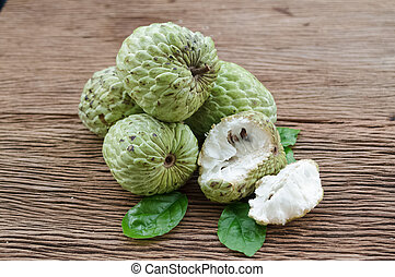 Custard apple fruit on the wood table