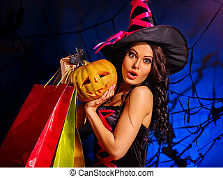 Woman holding Halloween shopping bag. - Happy woman holding...