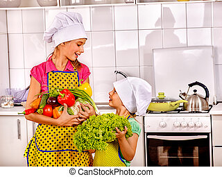 Children cooking on kitchen at home. - Children wearing...